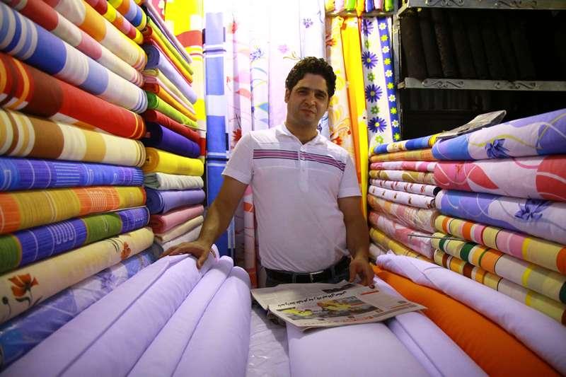 Cloth seller, Tehran, Iran.