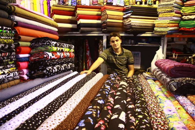 Cloth seller, Tehran, Iran.
