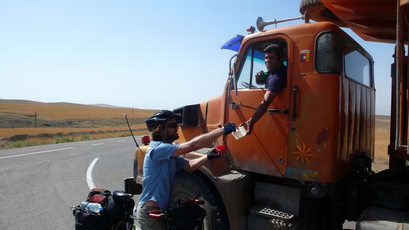 Getting a cup of tea from a truck driver near Ardibil, Iran.