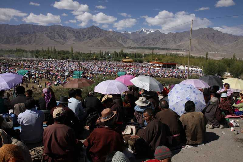 Tens of thousands of locals crowd in to listen to the Dalai Lhama