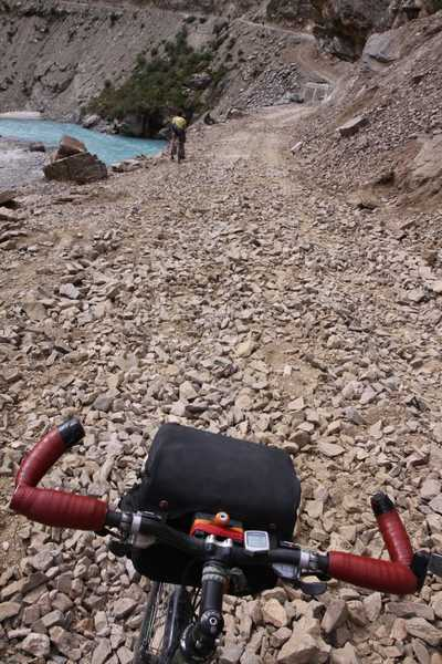 What is called a road in India. Tough cycling.