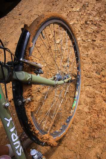 Cycling through thick, sticky mud.