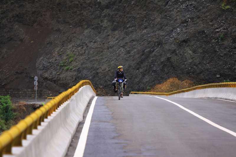Crossing an, as yet, unopened bridge.