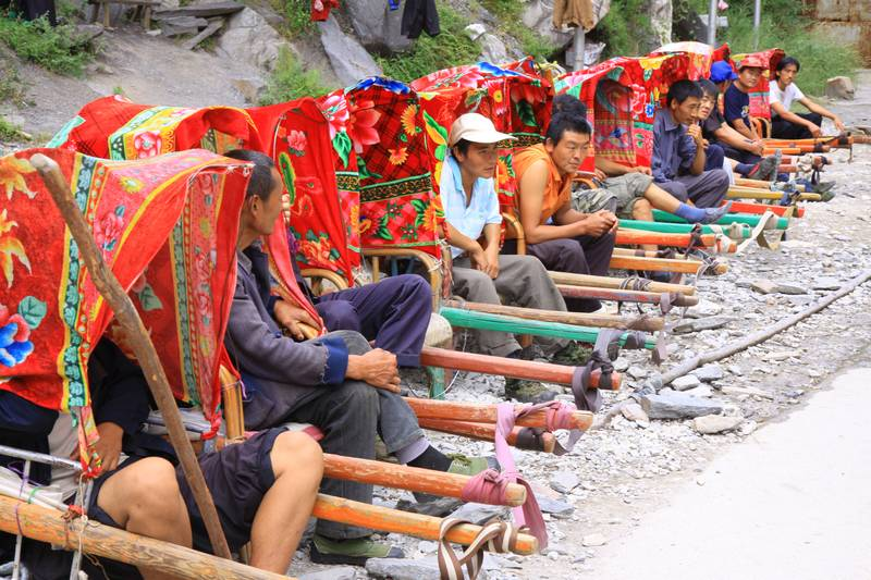 These guys are ready and waiting for the next lazy tourist who wants to be carried down to the river and back.