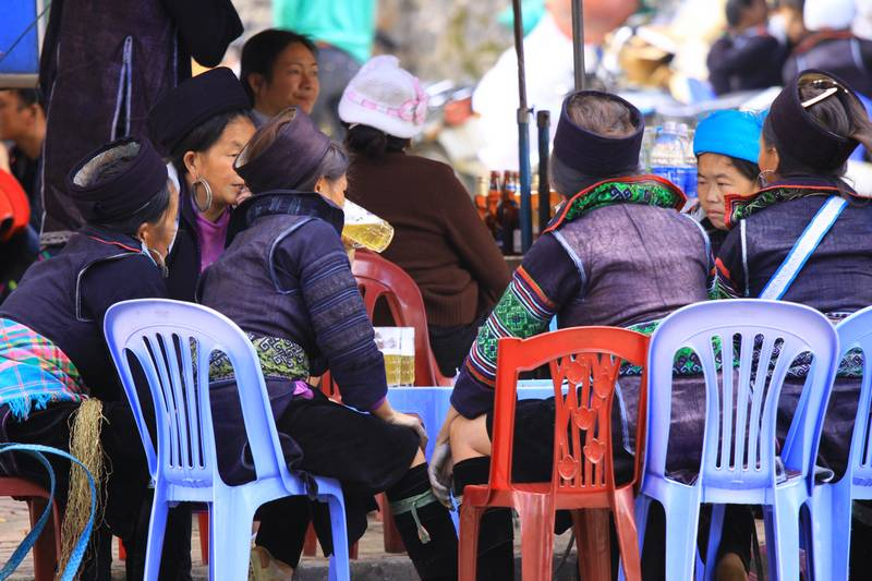Local women drinking beer by the road side in Sapa