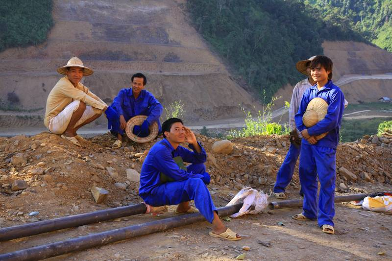 Workers resting from the hot sun on a huge dam project near Muang Noi (formally Lau Chai)