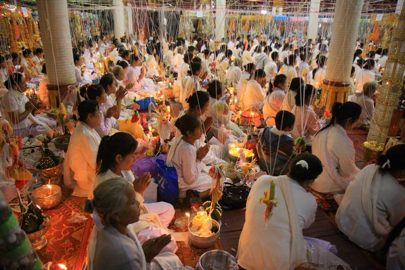 Nuns pray in an all night ceremony in Pakse, Laos.