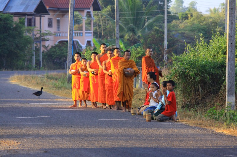 Monks receiving their offering of rice on one of the islands.