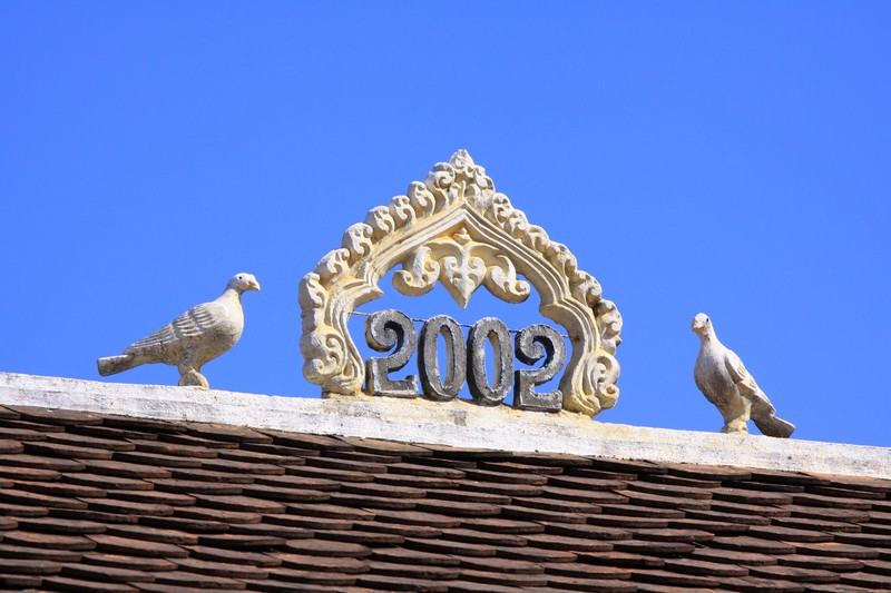 These ornamintes sit on the crest of every rooftop indicating the year of construction.