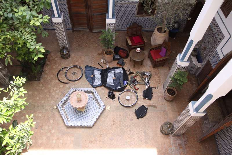 Assembling my bike at the beautiful hostel in Merrakech.