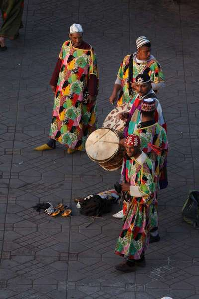 African dancers busking in the square.