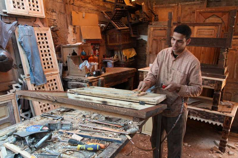 A woodworker creates masterpieces from recycled doors and windows.