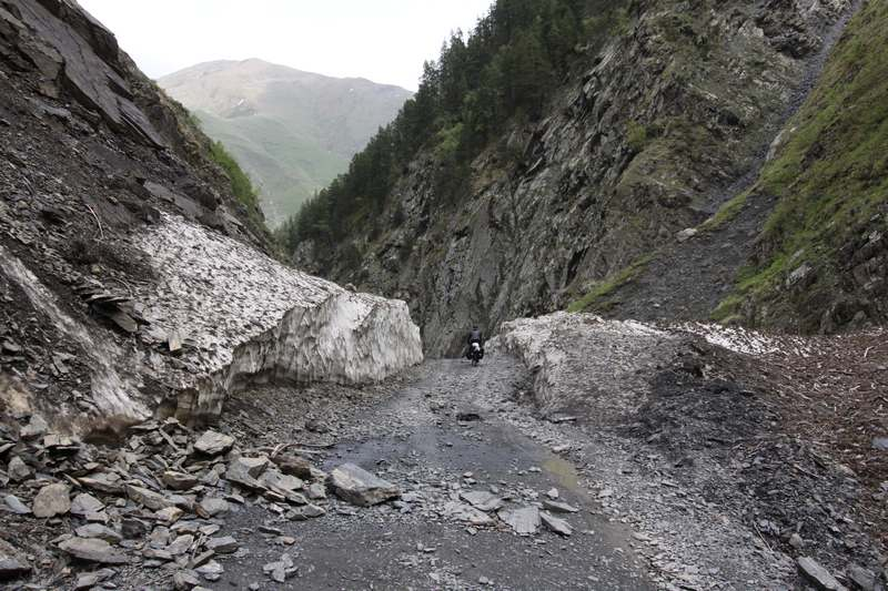 The road cut through the avalanche debris.