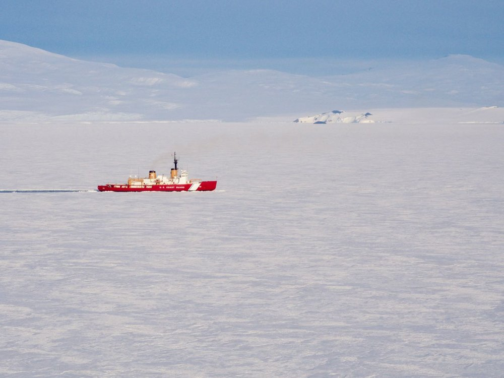 The Polar Star icebreaker inching close to McMurdo Station.