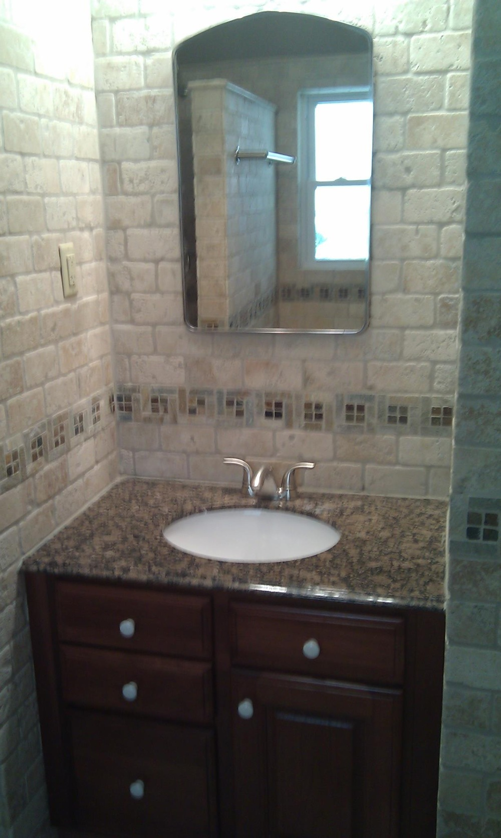 Mix our travertine with our granite vanity tops