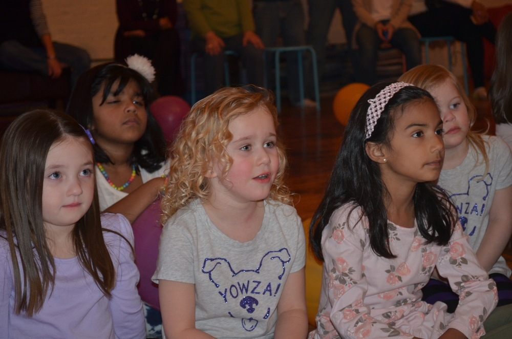 Party guests watch Gem's hoopdance performance