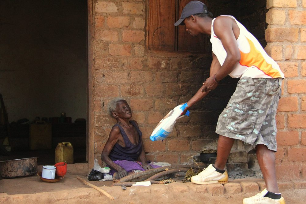 Director Of Ugandan Affairs: Godfrey Mugisha hands out malaria nets in Mpigi, Uganda