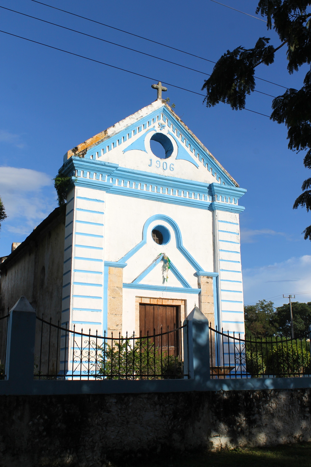 The bright blue church (facade) in Granada, Yucatan.