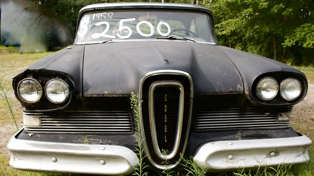 "Matt Young , of Topsham, Maine says he'd ""rather sell it than plow around it this winter.""  He's asking $2,500 for this 1958 Edsel.  He got it in trade for a late 1940s  Ford .   Matt  does a lot of swapping. His business cards say he's into ""anything automotive.""   Young  says the car can be driven and that the original engine is under the massive hood.  He proudly points to the steering wheel which featured one of  Edsel's  many original ideas, pushbutton gear shifting. And the two tone beige-black upholstery is a hint that, many years ago, the car was distinctive.  Pricing began at about $2,700 and went as high as $3,766, according to  Wikipedia . Today, a well restored two door 1958 Edsel is worth about $21,000."