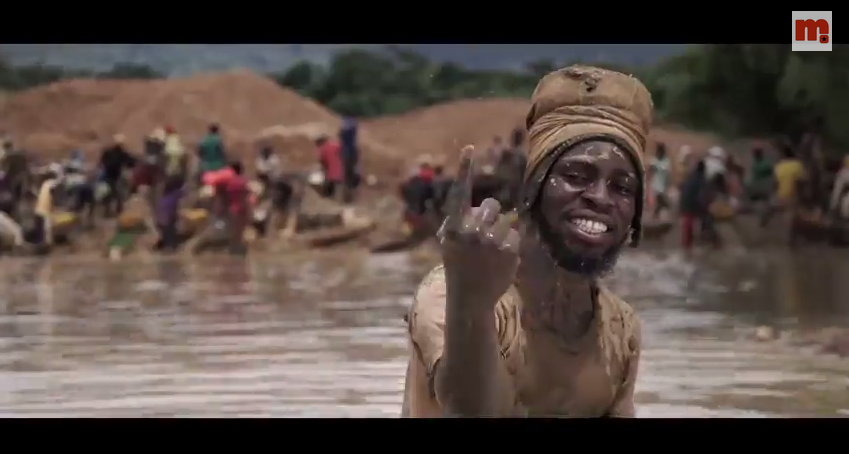 M.anifest panning for gold in Ghana
