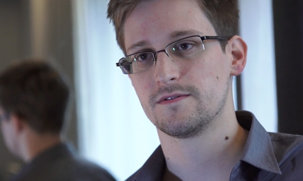 Edward Snowden answers your most burning questions, but none of Twitter's tongue-in-cheek queries about his love life. (Photo via The Guardian)