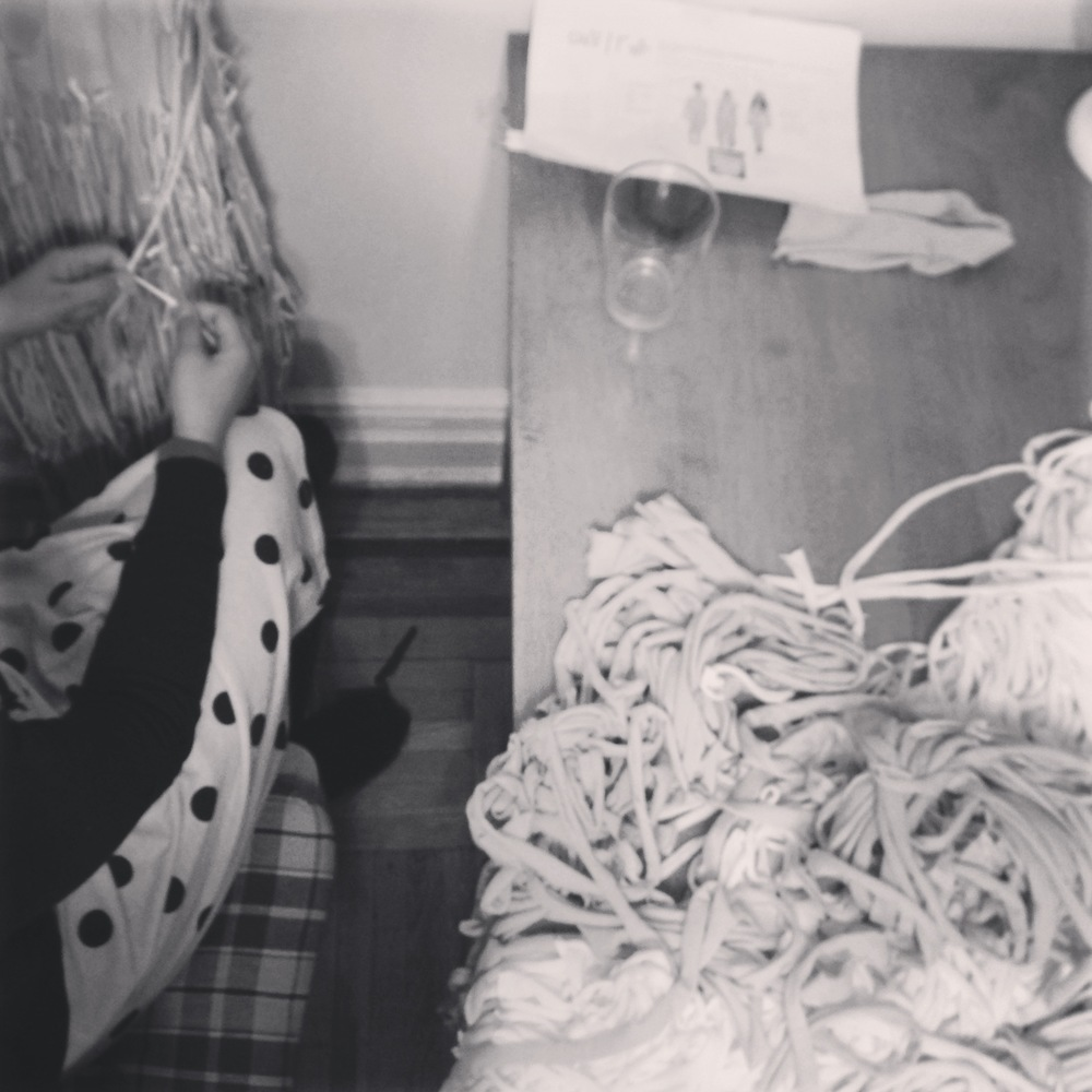 Recycled jersey strips being knotted and tied onto costumes. Photo by Zaida Adriana Goveo Balmaseda