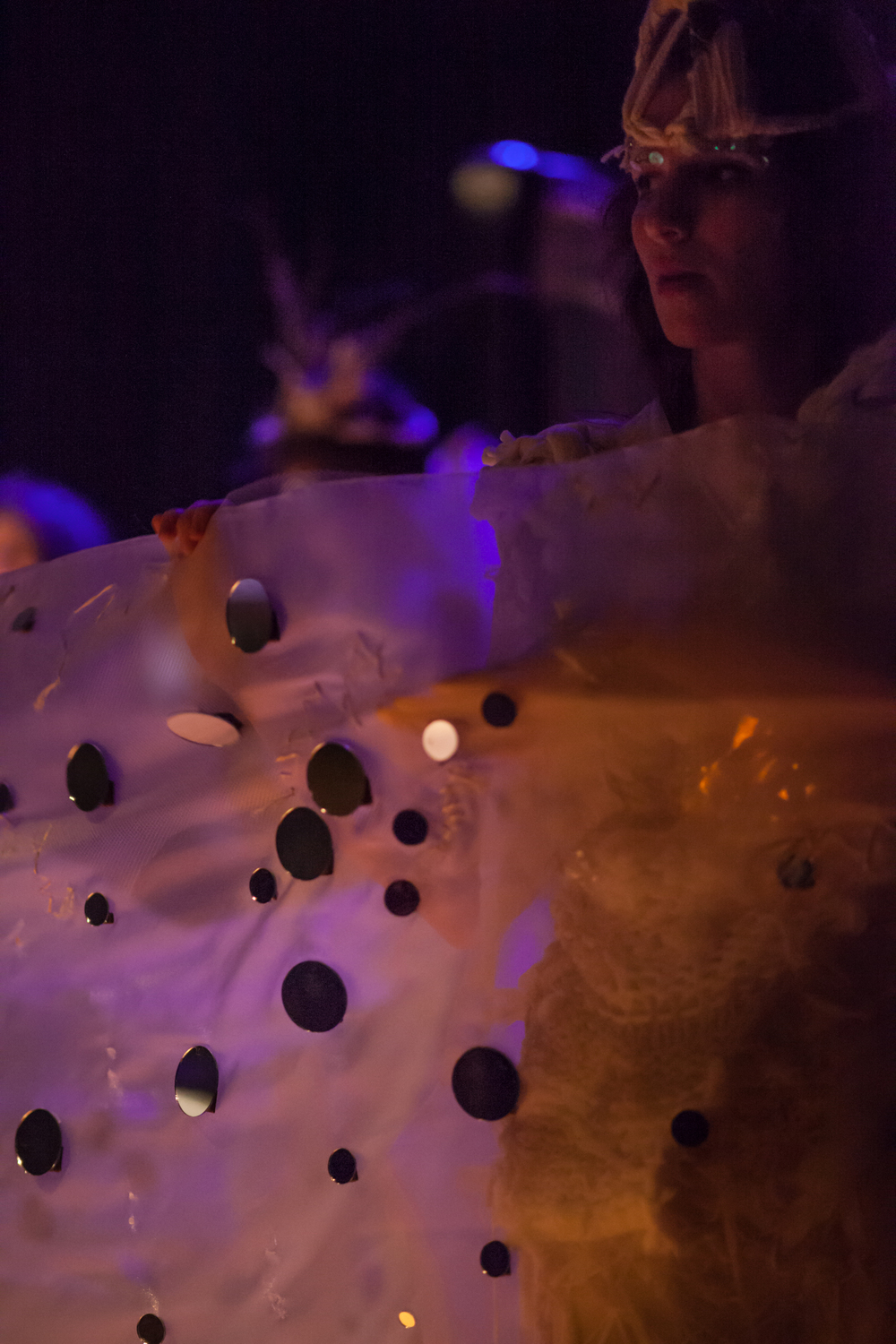 THIRD MOVEMENT: Bodiless' creatures  cocoon-ed into a light-reflecting fabric that united them, and allowed them to share some of their light with the audience. Photo by Mekko Harjo