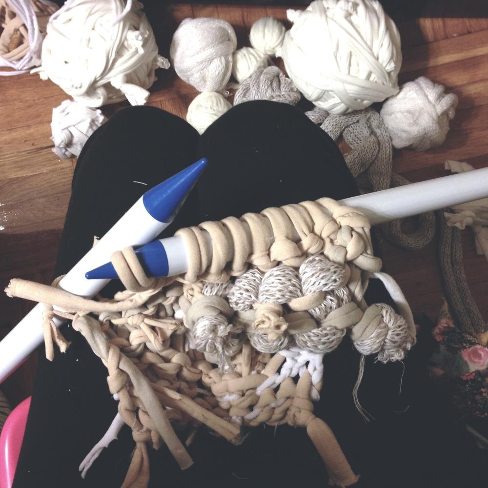 Hand-knitting 'addendums' with 25mm needles. Photo by Zaida Adriana Goveo Balmaseda