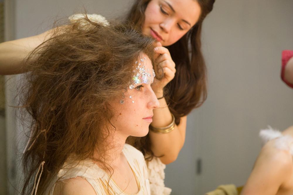Backstage: Zaida Adriana Goveo Balmaseda working on Ariadne Greif's hair and makeup. Photo by Dorian Iten