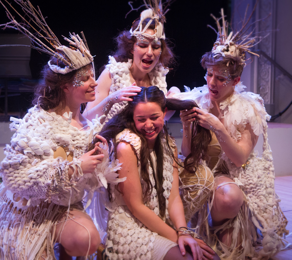 Left to right: Gabrielle Herbst, Ariadne Greif and Lucy Dhegrae surrounding Zaida post-show. Photo by Dorian Iten
