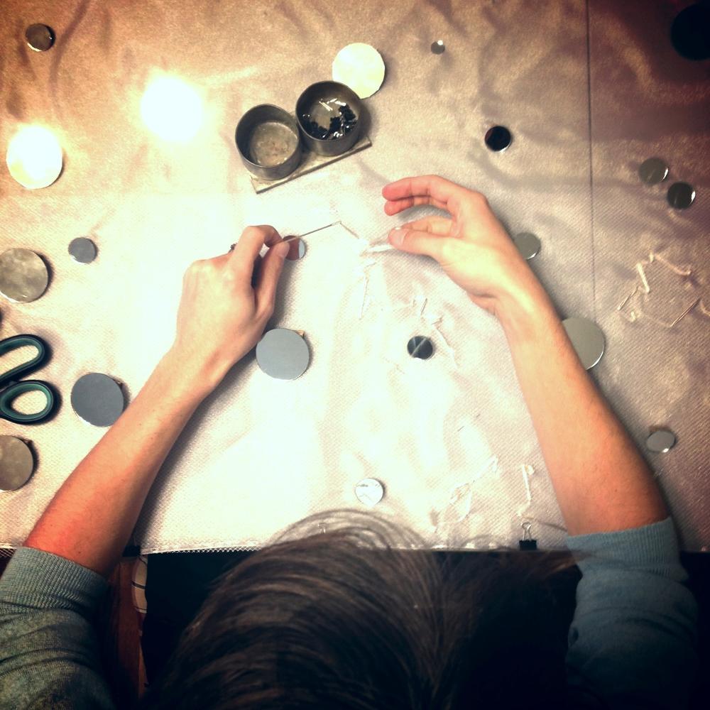 Dorian Iten working on the light-reflecting cloth for the third movement. Photo by Zaida Adriana Goveo Balmaseda