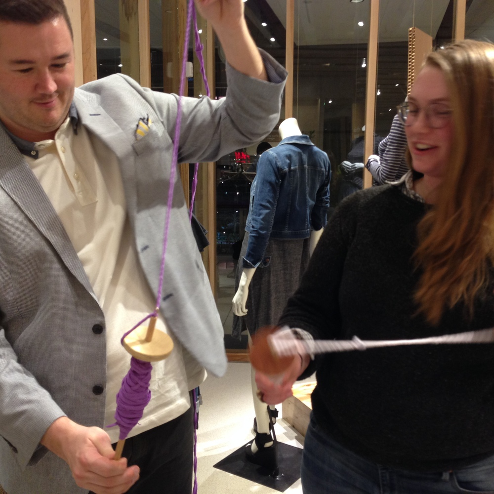 Sophie Engel showing one of the Eileen Fisher sales associates how to spin. Photo byZaida Adriana Goveo Balmaseda