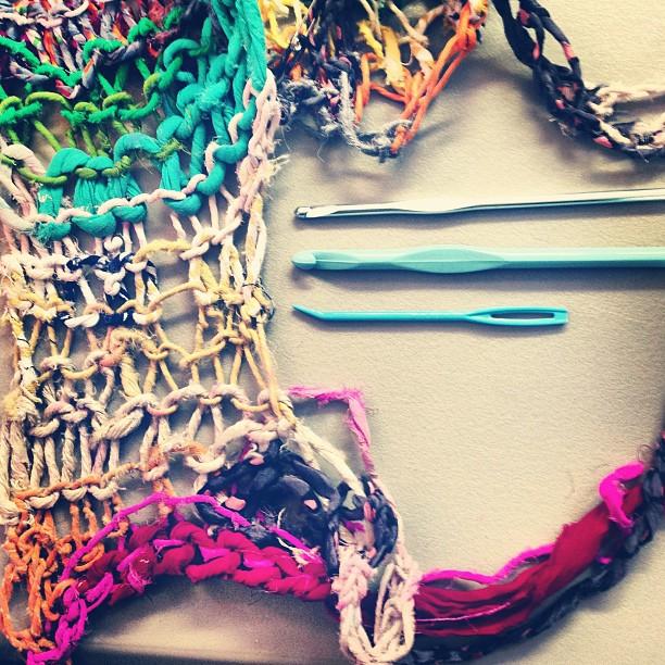 Finishing a hand-knit camisole made from hand-spun recycled fiber yarn swatch.Photo by Zaida Adriana Goveo Balmaseda