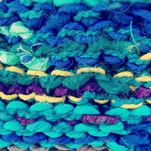 Detail of a monochromatic hand-knit hand-spun recycled fiber yarn swatch.Photo by Zaida Adriana Goveo Balmaseda