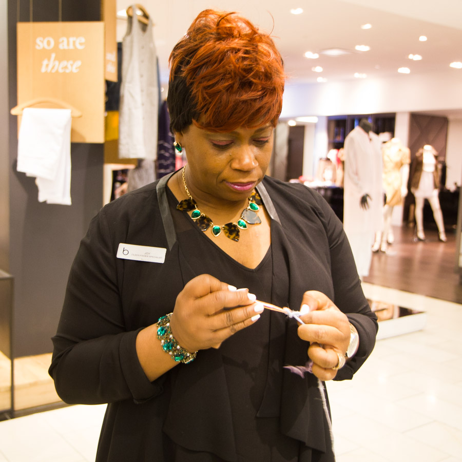 Joy, one of the Eileen Fisher at Bloomingdale's sales associates crocheting with our hand-spun recycled fiber yarn. Photo by Dorian Iten