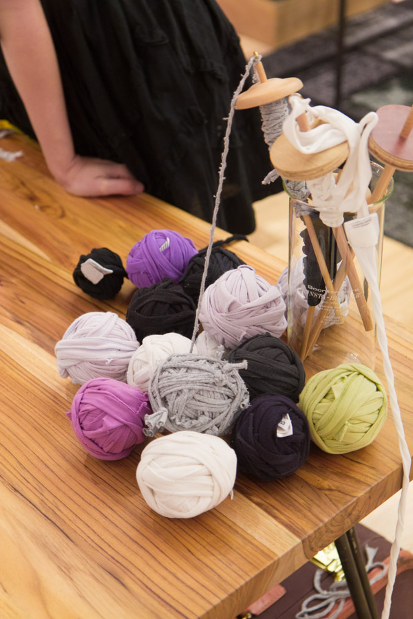 Cut t-shirts and wooden spindles at the Eileen Fisher/Bloomingdale's spinning workshop. Photo by Dorian Iten