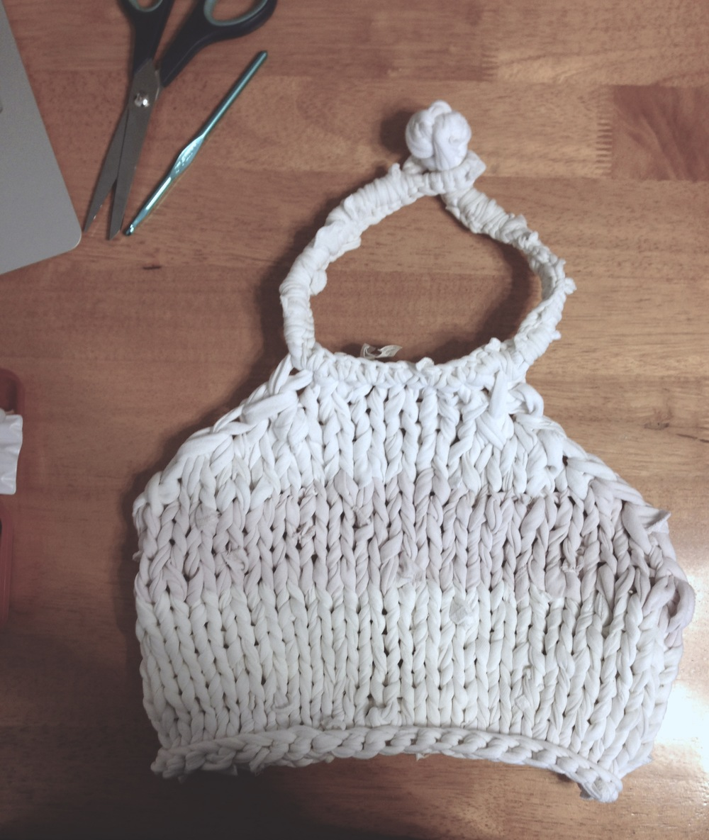WORK IN PROGRESS: on to crochet the border of the hand-knit recycled T-shirt yarn cropped halter top for Amabelle at estudioBALMASEDA. Photo by Zaida Adriana Goveo Balmaseda