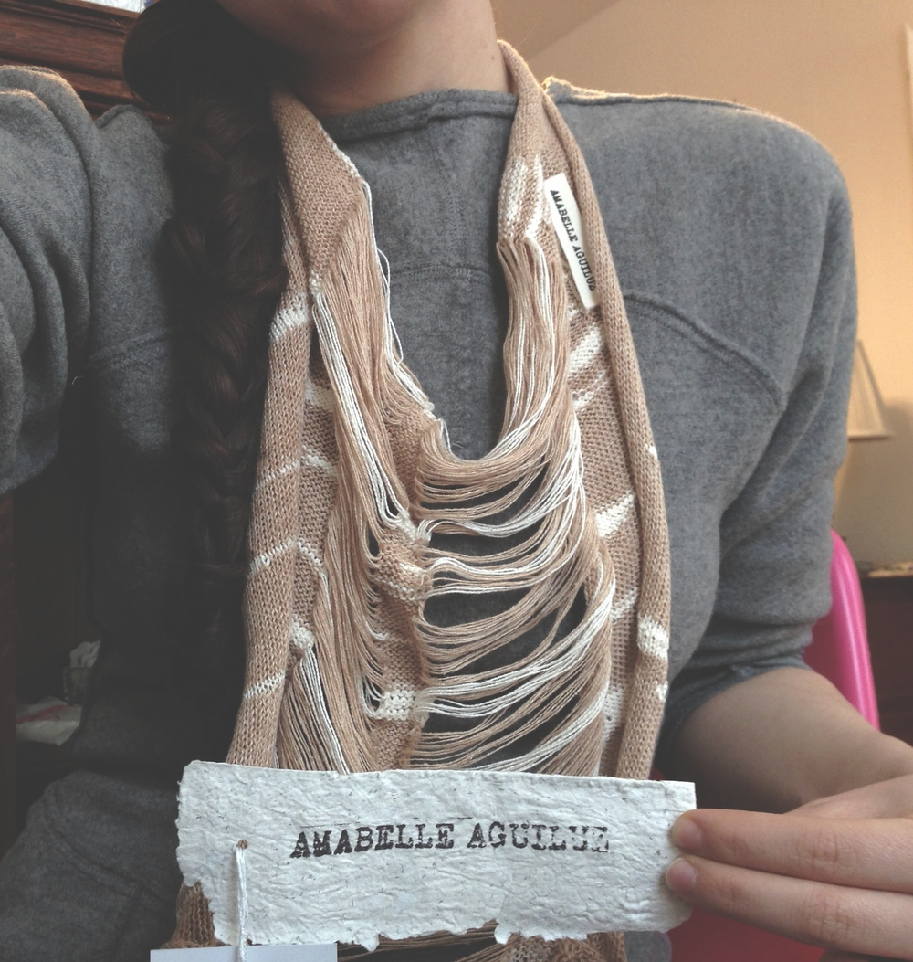 Zaida Adriana Goveo Balmaseda wearing her new Amabelle Aguiluz Spirit Scarf #INSIDEOUT on Fashion Revolution Day, and showing off Amabelle's beautiful handmade paper tag. Photo by Zaida Adriana Goveo Balmaseda