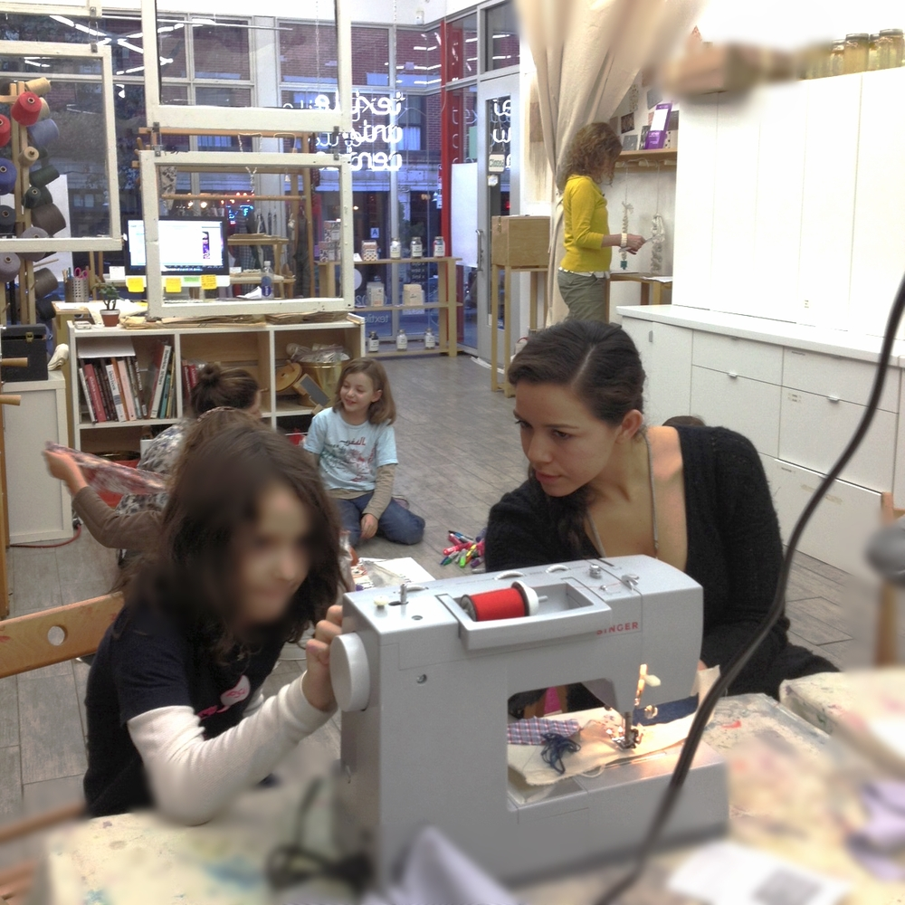 While at TAC, I also helped teach some of the afterschool/youth programs (ages 5-9). Here during the Sewing and Fashion segment. Winter 2013. Photo by Fran Caselli.