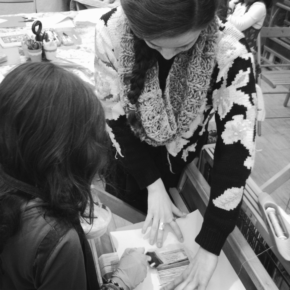 Helping one of the #kidsofTAC paint her warp during the Weaving segment of the afterschool program. Winter 2013. Photo by Fran Caselli.