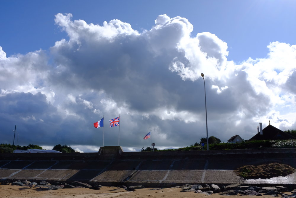 The French, British and American flags fly proudly everywhere you go in Normandie.