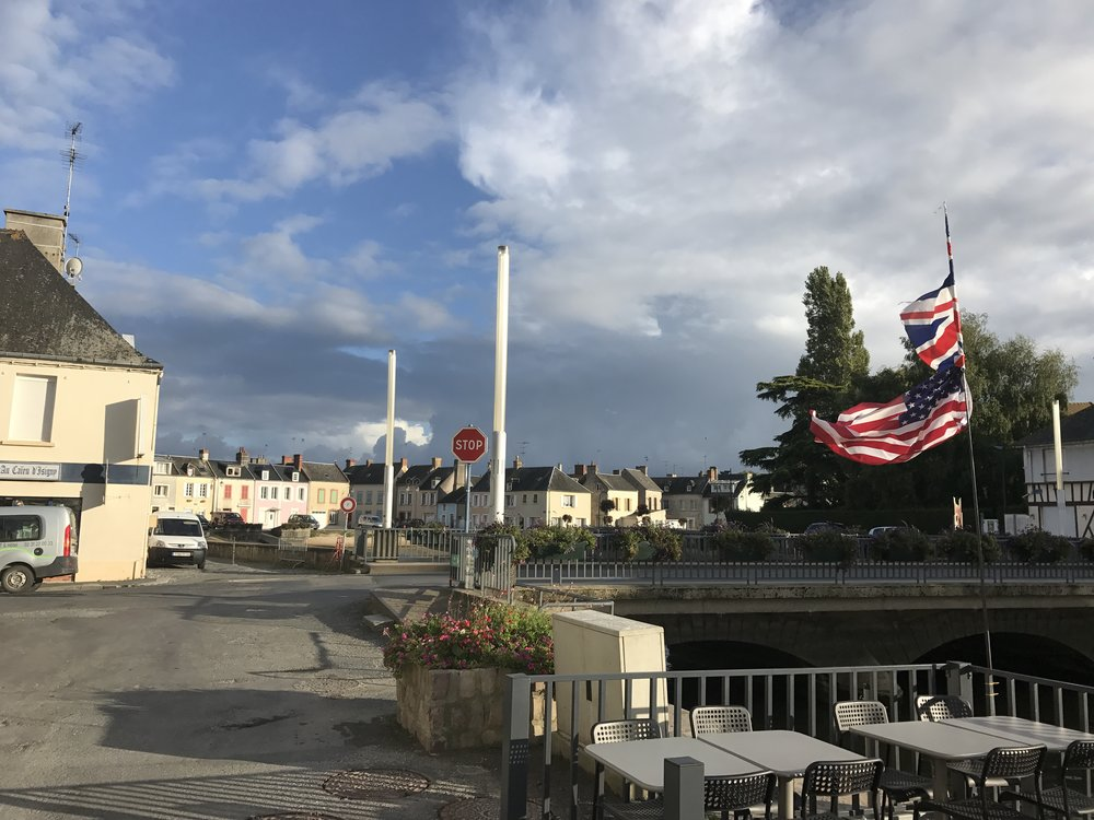 American and British flags flying on the bridge in Isigny-sur-mer where my grandfather helped liberate the town on the 8th of June 1944.