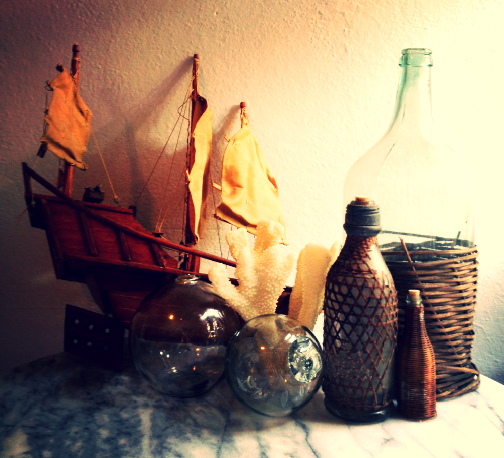 Prop styling, nautical decor,antique vintage wicker bottles and glass floats