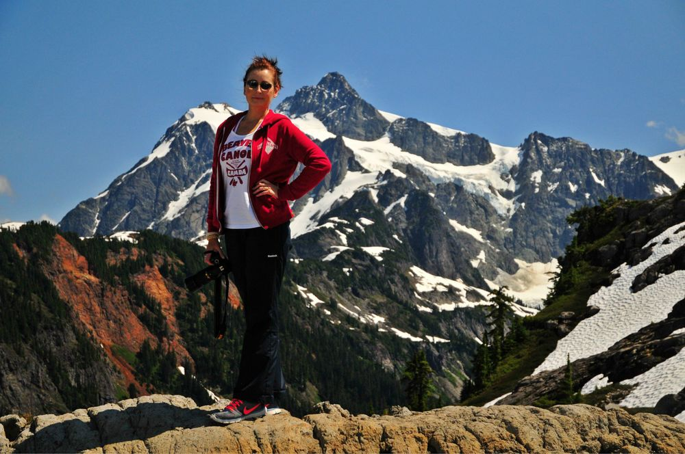 Brandy Saturley with Nikon in front of Mt. Baker peak.