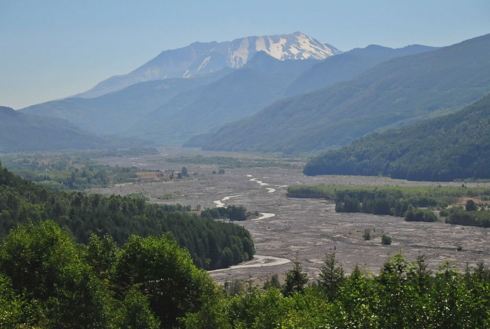 Mt. Saint Helens and the muddy, silt filled river.