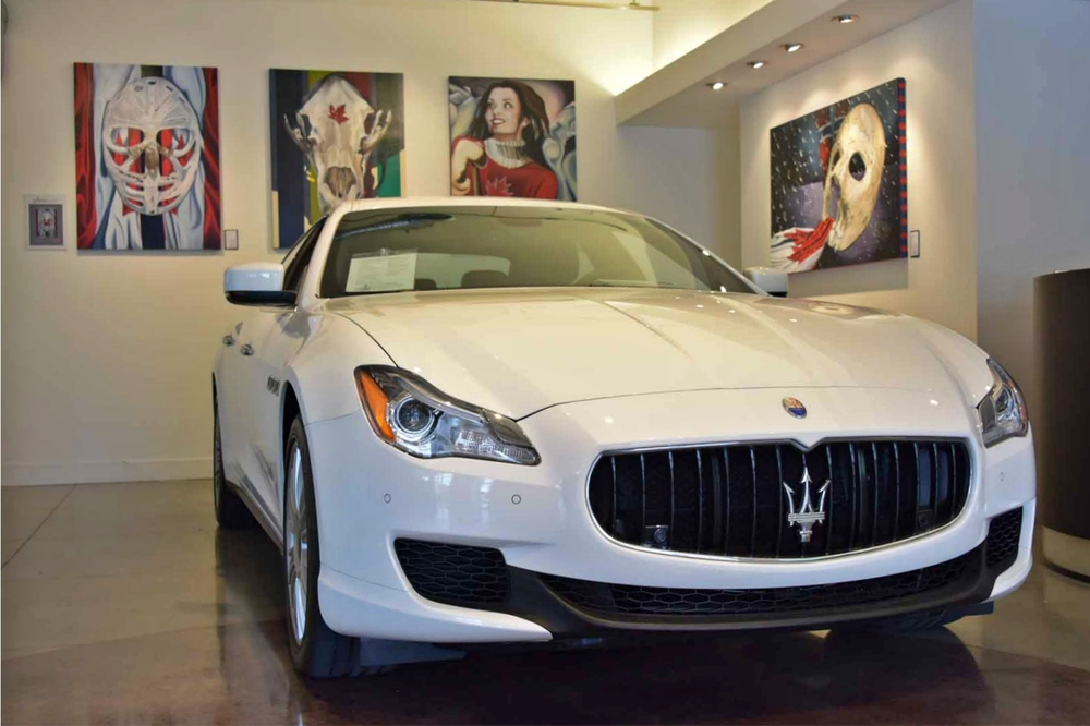 Goalie's Mask: red, white & Dryden, HBC SKull, Saint Kanata, Plante Rising all paintings by Brandy Saturley. Maserati Quattroporte Q4 by Victoria Premium Automobiles Ltd.