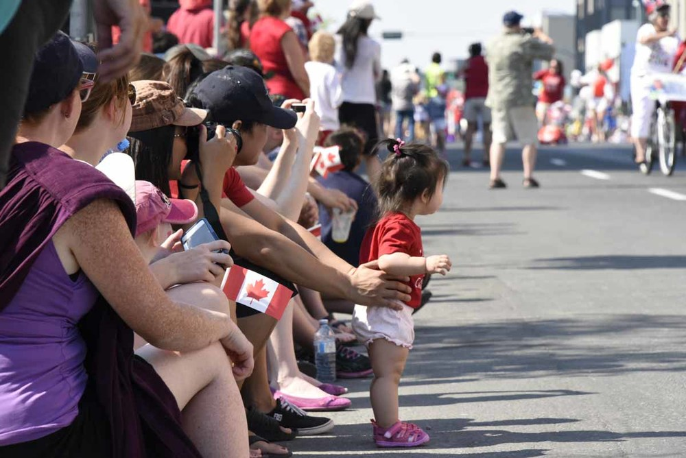 People enjoying the Canada Day parade in Yellowknife