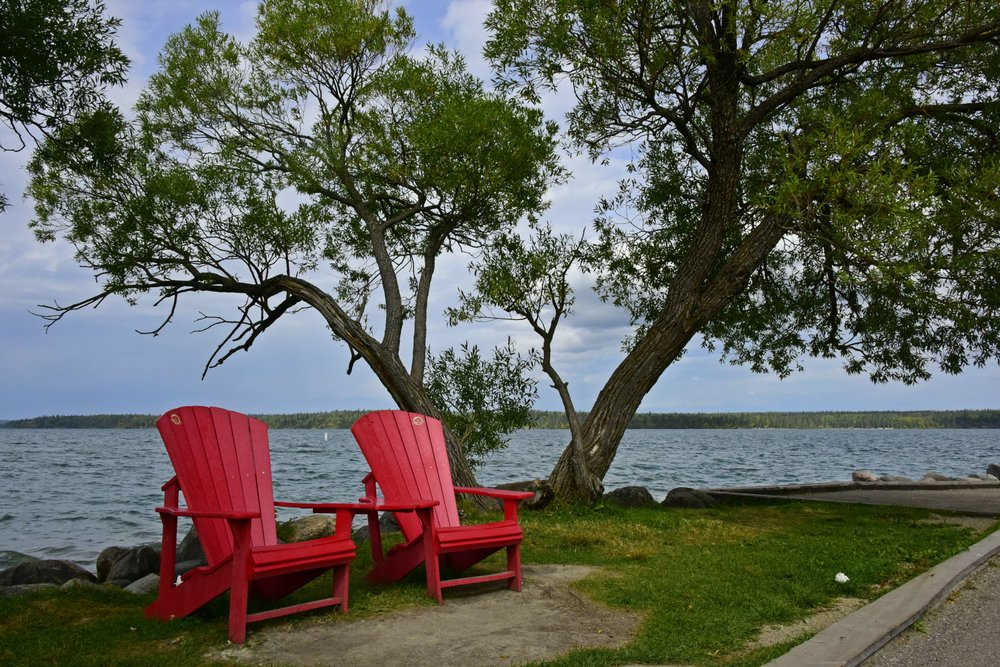 Parks Canada red Adirondack chairs at Clear Lake, Manitoba