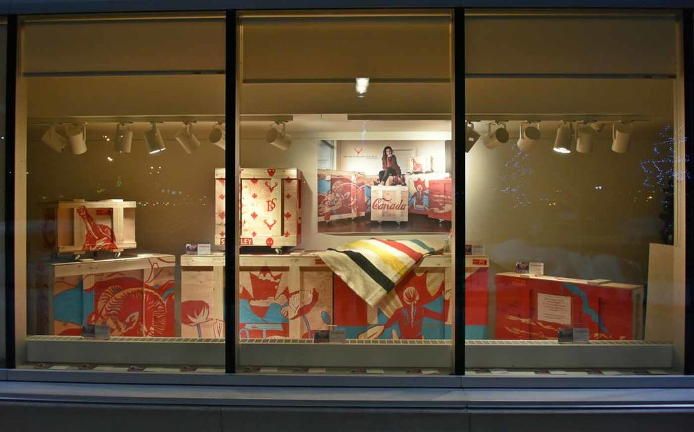 CANADIANISMS: A Half Decade Inspired by Canada - front window Strathcona County Art Gallery @501 - showing hand painted art crates by Brandy Saturley