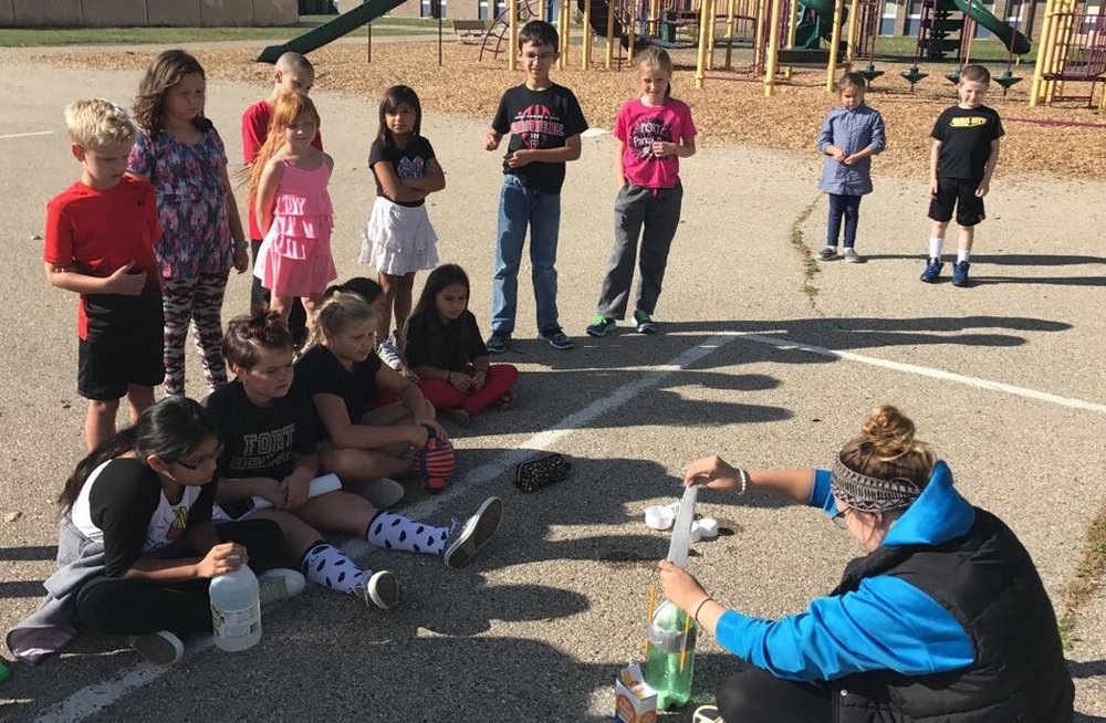 Luther Club members building and testing rockets. -